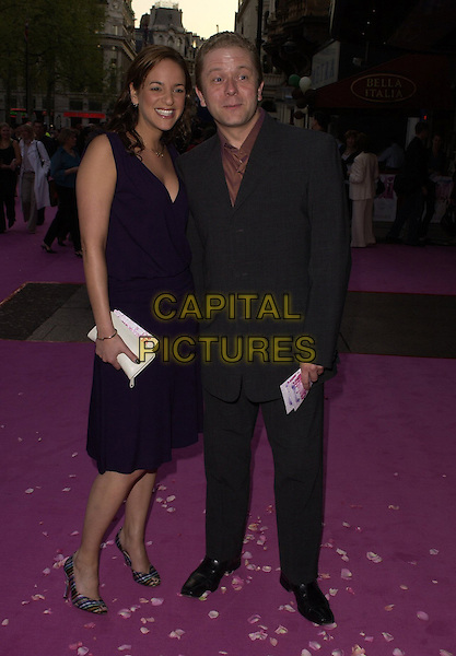 "JOHN CULSHAW & GUEST.""Confetti"" world premiere at Vue West End, London, UK..May 3rd, 2006.Ref: CAN.full length purple black suit dress.www.capitalpictures.com.sales@capitalpictures.com.©Capital Pictures"