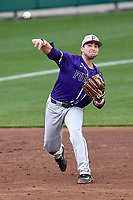 Third baseman Jake Crawford (19) of the Furman Paladins makes a throw to first base during the game against the Clemson Tigers on Tuesday, February 20, 2018, at Doug Kingsmore Stadium in Clemson, South Carolina. Clemson won, 12-4. (Tom Priddy/Four Seam Images)