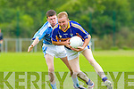 Cordal's Mossie Enright goes past Firies Ian Crowley during their leaague clash in Farranfore on Sunday