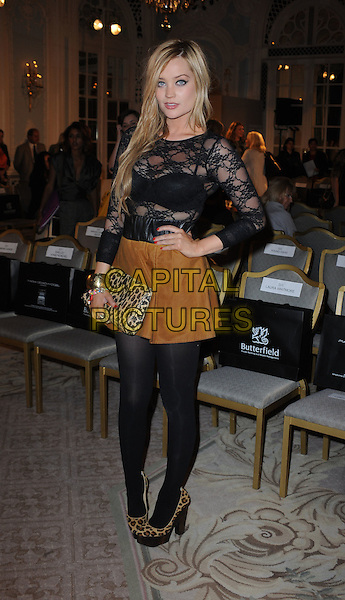 Laura Whitmore.London Fashion Week, Covent Garden, London, England..September 16th, 2011.LFW full length black lace top see through thru bra brown skirt gold bracelet leopard print clutch bag tights shoes hand on hip. CAP/WIZ.© Wizard/Capital Pictures.