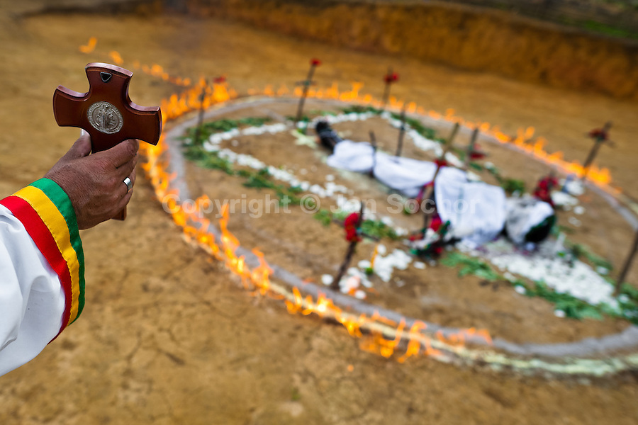 Hermes Cifuentes, a Colombian spiritual healer, helds a crucifix in his hand during a ritual of exorcism in La Cumbre, Colombia, 28 May 2012. Exorcism is an ancient religious practice of evicting spirits, generally called demons or evil. Although the formal catholic rite of exorcism is rarely seen and must be only conducted by a designated priest, there are many pastors and preachers in Latin America performing exorcism ceremonies. The 52-year-old Brother Hermes, as the exorcist calls himself, claims to have been carrying out the healing rituals for more than 20 years. Using fire, dirt, candles, flowers, eggs and other natural-based items, in conjunction with Christian religous formulas, he attempts to drive the supposed evil spirit out of a victim's mind and body.
