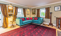 BNPS.co.uk (01202) 558833. <br /> Pic: Strutt&Parker/BNPS<br /> <br /> Sitting room. <br /> <br /> Have Nessie for a neighbour...<br /> <br /> A beautifully-restored 19th century farmstead just minutes from Loch Ness with stunning Highland views is on the market for £675,000.<br /> <br /> The Steading is in the ancient village of Dores and has been lovingly restored and transformed to create a stylish yet cosy home.<br /> <br /> The house is just a few minutes' walk from the beach at Dores and on a clear day from the shore you can see all the way to the opposite end of the iconic loch - 25 miles away at Fort Augustus - which would be a perfect spot to hunt for its famous monster.<br /> <br /> The Steading would be an ideal property for someone looking for a peaceful, rural retreat in the Scottish Highlands, or could be a good investment property to rent out to holidaymakers.