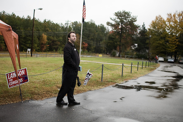 November 4, 2008. Durham, NC.. John D'Amore, an H&R Block employee, hands out advertisements at a polling station.. He said because of all the talk in the campaign about taxes, the company was hoping to get new clients..