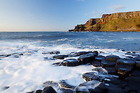 Waves splashing over basalt columns near sunset, Giant's Causeway, County Antrim, Northern Ireland, United Kingdom