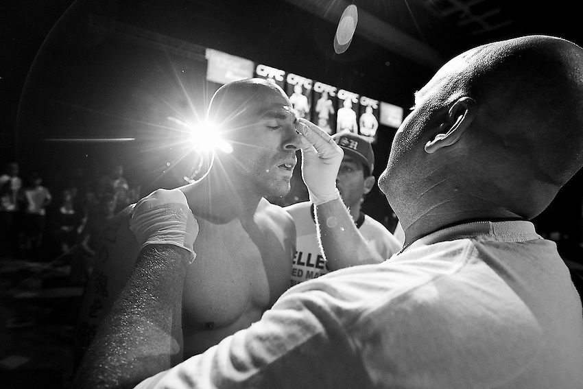 Cornerman Mike Skowronski (right) wipes down George Sullivan with vaseline as he prepares to enter the cage for his welterweight MMA fight against Jesus Martinez at the Borgata in August.