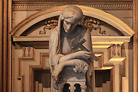 Meditation, sculpture in white marble of a veiled woman leaning forward, holding a cross, deep in thought, 1864, by Louis-Joseph Daumas, 1801-87, in La Chapelle de la Trinite or the Chapel of the Trinity in the Chateau de Fontainebleau, France. The Palace of Fontainebleau is one of the largest French royal palaces and was begun in the early 16th century for Francois I. It was listed as a UNESCO World Heritage Site in 1981. Picture by Manuel Cohen