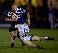 Bath Rugby's Tom Homer is tackled by Gloucester's Dom Coetzer<br /> <br /> Photographer Bob Bradford/CameraSport<br /> <br /> Gallagher Premiership - Bath Rugby v Gloucester Rugby - Monday 4th February 2019 - The Recreation Ground - Bath<br /> <br /> World Copyright © 2019 CameraSport. All rights reserved. 43 Linden Ave. Countesthorpe. Leicester. England. LE8 5PG - Tel: +44 (0) 116 277 4147 - admin@camerasport.com - www.camerasport.com