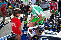 18 SEP 2010 - LA BAULE, FRA - Jonathan Brownlee (EC Sartrouville) signs an autograph before the start of the 2010 Mens French Club Championship Final (PHOTO (C) NIGEL FARROW)