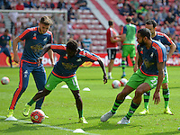 (l-r) Matt Grimes of Swansea City, Nathan Dyer of Swansea City  and Kyle Bartley of Swansea City warm up before kick off during the Barclays Premier League match between Sunderland and Swansea City played at Stadium of Light, Sunderland