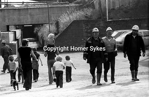Miners, South Kirkby Colliery, Yorkshire England. Coal Miners story 1979. These Miners are probably surface workers walking towards the pit canteen or pit head baths. The families are  walking towards a common rite of way via the subway leading  towards South Kirkby. <br />