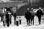 Coal Miners, South Kirkby Colliery, Yorkshire England. 1979. These Miners are probably surface workers walking towards the pit canteen or pit head baths. The families are  walking towards a common rite of way via the subway leading  towards South Kirkby. <br />