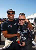Mar 19, 2017; Gainesville , FL, USA; NHRA top fuel driver Antron Brown (left) and funny car driver Jonnie Lindberg during the Gatornationals at Gainesville Raceway. Mandatory Credit: Mark J. Rebilas-USA TODAY Sports