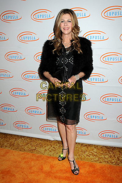 RITA WILSON .Lupus LA Orange Ball 2010 held at the Beverly Wilshire Hotel, Beverly Hills, California, USA, 6th May 2010..full length black dress fur coat t-bar open toe shoes sandals clutch bag jacket fluffy furry.CAP/ADM/BP.©Byron Purvis/AdMedia/Capital Pictures.