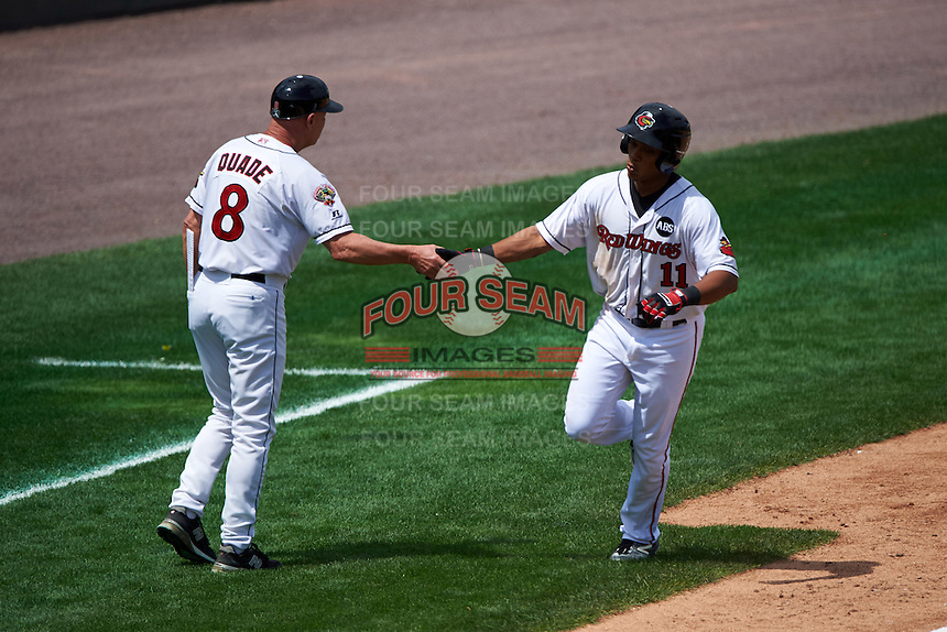 Rochester Red Wings designated hitter Jorge Polanco (11) is congratulated by manager Mike Quade (8) after hitting a home run during a game against the Columbus Clippers on June 16, 2016 at Frontier Field in Rochester, New York.  Rochester defeated Columbus 6-2.  (Mike Janes/Four Seam Images)