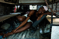 Port Au Prince, Haiti, Jan 18 2010.Marielle, 17, sleeps on the back of a pick up as her house was totally destroyed..