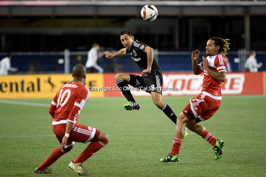 May 23, 2015 - Foxborough, Massachusetts, U.S. - D.C. United midfielder Davy Arnaud (8) plays the ball between New England Revolution midfielder Jermaine Jones (13) and forward Teal Bunbury (10) during the MLS game between DC United and the New England Revolution held at Gillette Stadium in Foxborough Massachusetts. The New England Revolution and D.C. United ended the game tied 1-1.  Eric Canha/CSM