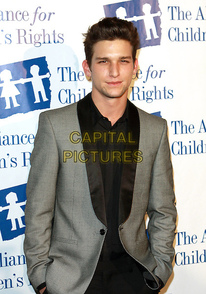 DAREN KAGASOFF.The Alliance For Children's Right Dinner Gala held at  The Beverly Hilton Hotel, Beverly Hills, CA, USA..February 10th, 2010.half length black top grey gray suit jacket .CAP/ADM/TC  .©T.Conrad/AdMedia/Capital Pictures.