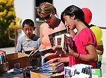 Georgina Velasquez and her kids Edwin Orozco-Velasquez, 9, and Nitza Velasquez, 11, look through the book selection at the Summer Reading Program Pancake Breakfast Kick-Off at the Carson City Library, in Carson City, Nev., on Saturday, June 8, 2013. <br /> Photo by Cathleen Allison