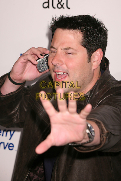GREG GRUNBERG.AT&T's BlackBerry Curve Launch Party at the Beverly Wilshire Hotel, Beverly Hills, California, USA,.31 May 2007..half length on mobile phone funny hand .CAP/ADM/BP.©Byron Purvis/AdMedia/Capital Pictures.