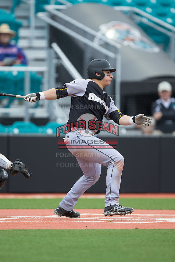 Michael Gasper (7) of the Bryant Bulldogs follows through on his swing against the Coastal Carolina Chanticleers at Springs Brooks Stadium on March 13, 2015 in Charlotte, North Carolina.  The Chanticleers defeated the Bulldogs 7-2.  (Brian Westerholt/Four Seam Images)
