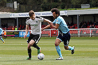 Joshua Gowling of Grimsby Town (right) holds off the Dover attack during the Vanarama National League match between Dover Athletic and Grimsby Town at the Crabble Athletic Ground, Dover, England on 16 April 2016. Photo by Tony Fowles/PRiME Media Images.