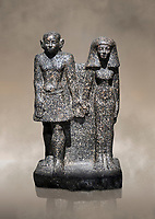 Ancient Egyptian bust of a man and women, serpentine, Middle Kingdom, late 12th-13th Dynasty (1800-1700 BC). Egyptian Museum, Turin. black background<br /> <br /> An example of Egyptian private statues, probably low ranking officials, inv 1222 &1233