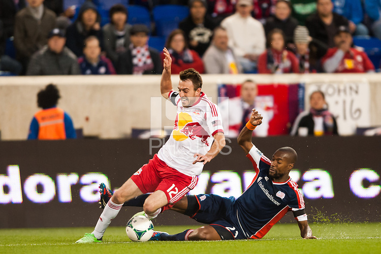 Jose Goncalves (23) of the New England Revolution fouls Eric Alexander (12) of the New York Red Bulls. The New York Red Bulls defeated the New England Revolution 4-1 during a Major League Soccer (MLS) match at Red Bull Arena in Harrison, NJ, on March 20, 2013.