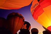 Hot air balloons illuminated by the flames at twilight at the Alberquerque balloon festival USA