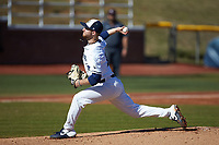 Wingate Bulldogs starting pitcher Austin Mitchell (16) delivers a pitch to the plate against the Concord Mountain Lions at Ron Christopher Stadium on February 2, 2020 in Wingate, North Carolina. The Mountain Lions defeated the Bulldogs 12-11. (Brian Westerholt/Four Seam Images)