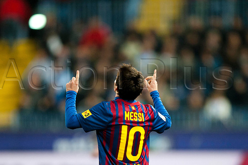 22.01.2012 Malaga, Spain. The La Liga football match between FC Malaga and FC Barcelona played in the La Rosaleda Stadium. Image shows, Lionel Messi from Argentina (FC Barcelona) reacts after scoring 0:4 against Malaga CF during a Spanish La Liga soccer match...