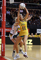 25.10.2012 Australia's Caitlin Bassett in action during the England v Australia netball test match as part of the Quad Series played at the TSB Arena Wellington. Mandatory Photo Credit ©Michael Bradley.