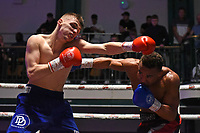 Denis Denikajev (blue shorts) draws with Ben Fields during a Boxing Show at York Hall on 8th June 2019