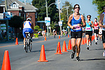 Bikers and runners share the same street during Valleyfield Triathlon.