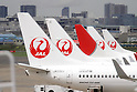 September 19, 2012, Tokyo, Japan - Japan Airlines jetliners are lined on the tarmac at Tokyo's Haneda Airport on Wednesday, September 19, 2012...Once the national flag carrier, JAL was delisted after going bankrupt in 2010. It has since carried out cost cuts and restructured, returning to solid profitability. JAL shares rose about 2 percent on their return to the stock market  following a 663 billion yen ($8.5 billion) initial public offering that nearly doubled the money that went into the once-bankrupt carrier's bailout. (Photo by AFLO) UUK -mis-.