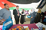 Women refugees from Syria receive a diploma from a member of the Jordanian parliament as they graduate from a Start Your Business course in Zarqa, Jordan. The 15-day course was sponsored by the Department of Service for Palestinian Refugees of the Middle East Council of Churches, a member of the ACT Alliance. Refugees are not allowed to obtain formal employment in Jordan, but the women can run small businesses from their homes.