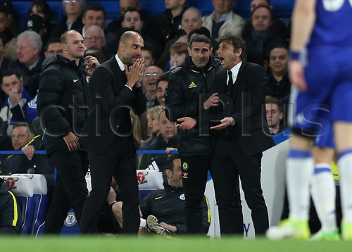 April 5th 2017, Stamford Bridge, Chelsea, London England; EPL Premier League football, Chelsea versus Manchester City; Manchester City Manager Pep Guardiola and Chelsea Manager Antonio Conte both confront each other from the touchline