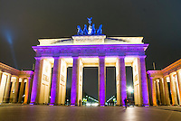 The Brandenberg gate Berlin festival of light, light show on the gate showing differnt colours each time.