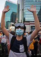 A pro-democracy protester is seen as they block the the main highway through Admiralty, next to the Hong Kong government headquarters in Hong Kong's downtown district, on the first day of the mass civil disobedience campaign Occupy Central, Hong Kong, China, 28 September 2014.