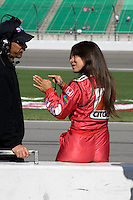 SAMAX Motorsport driver Milka Duno talks to her crew during practice laps for the Kansas Lottery Indy 300 at Kansas Speedway in Kansas City, Kansas on April 28, 2007.