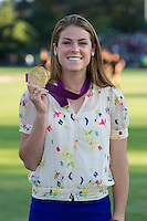 STANFORD, CA - August 17, 2012: Kelley O'Hara displays her Olympic gold medal before the Stanford vs Santa Clara women's soccer match in Stanford, California. Stanford won 6-1.