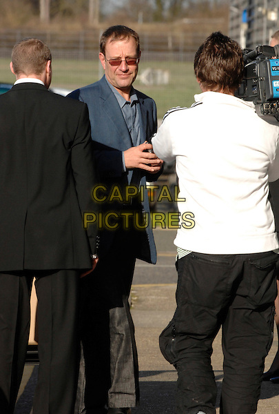 RICHARD DESMOND.arriving at Harrods Aviation private terminal, Stanstead, Essex, Leaving for Phillip Greene's birthday party in The Maldives, March 13th 2007..full 3/4 length talking on mobile phone.CAP/FIN.©Steve Finn/Capital Pictures.