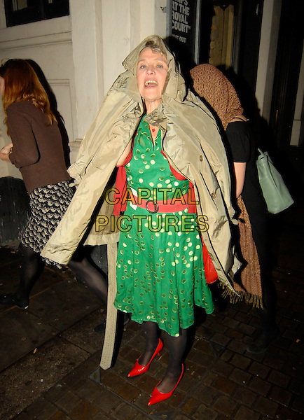 """JULIE CHRISTIE.""""Cries From The Heart"""", Royal Court Theatre, Sloane Square, London, England. .June 17th, 2007.full length beige coat jacket green dress shoes hiding covering funny gold polka dot mouth open belt .CAP/SW.©Stephen Walters/Capital Pictures"""