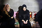 Relatives of Palestinian Mohammed Abu Halima, 22, who was shot dead by Israeli troops during clashes at Gaza-Israel border, mourn during his funeral in Gaza city on July 7, 2018. Photo by Mahmoud Ajour
