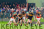 Action from the AIB Munster Club Junior Hurling Championship Quarter Final play last Sunday in Dromcollogher, Dr Crokes against Dromcollogher-Broadford. Jack Lenihan of Dr Crokes gets tackled by Garrett Noonan and Dee O'Leary of Dromcollogher-Broadford watched on by team mate Andrew Kennelly.