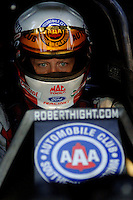 Apr 7, 2006; Las Vegas, NV, USA; NHRA Funny Car racer Robert Hight sits in the Auto Club Ford Mustang prior to qualifying for the Summitracing.com Nationals at Las Vegas Motor Speedway in Las Vegas, NV. Mandatory Credit: Mark J. Rebilas