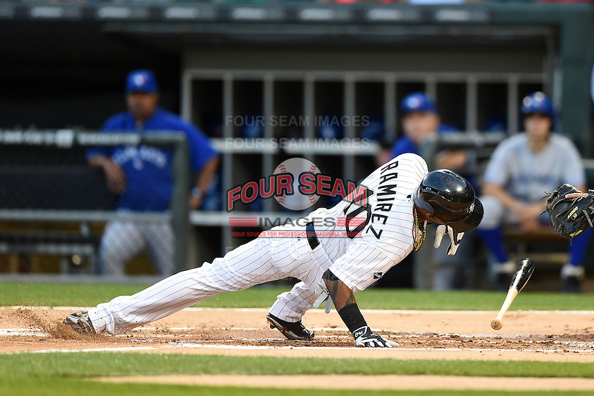 Chicago White Sox shortstop Alexei Ramirez (10) hits the ground after getting hit by a pitch in the hand during a game against the Toronto Blue Jays on August 15, 2014 at U.S. Cellular Field in Chicago, Illinois.  Chicago defeated Toronto 11-5.  (Mike Janes/Four Seam Images)