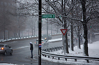 A man waits to cross a street in Cambridge, Massachusetts, USA, as Winter Storm Nemo approaches on Friday, Feb. 8, 2013.