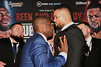 Daniel Dubois (L) pushes Joe Joyce during a Press Conference at the BT Tower on 7th February 2020
