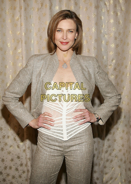 BRENDA STRONG.5th Annual Awards Season Diamond Fashion Show Preview, hosted by the Diamond Information Center and Instyle Magazine at the Beverly Hills Hotel, Beverly Hills, California. .January 12th, 2006.Photo: William Scott/AdMedia/Capital Pictures.Ref: WS/ADM.half length  hands on hips grey gray jacket white top.www.capitalpictures.com.sales@capitalpictures.com.© Capital Pictures.