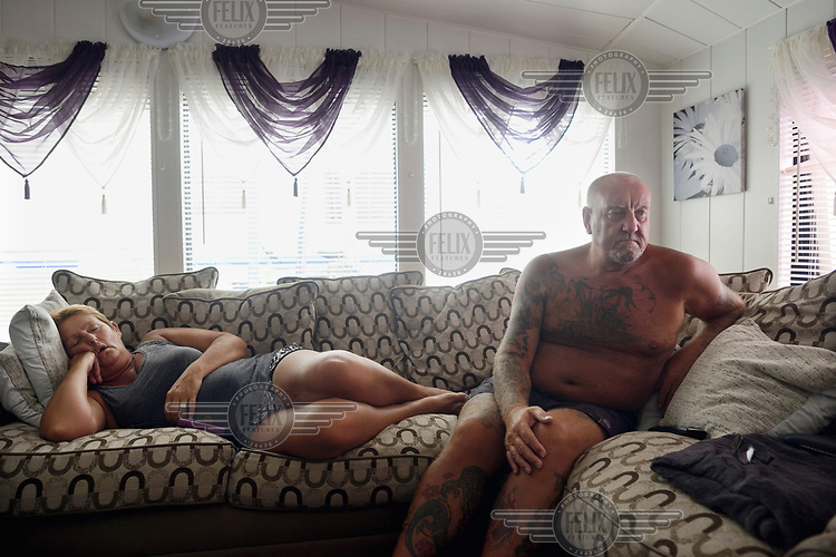 Robert Ballance (58) watches television while his wife sleeps inside the mobile home where they live most of the year on a camp site in Benidorm.  <br /> Benidorm is one of the biggest tourist destinations in Spain and also home to thousands of ex-patriot British citizens. Brexit has left them waiting anxiously to learn their status once the UK leaves the EU.